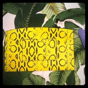 REED yellow python print pouch